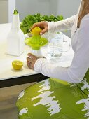 A woman juicing a lemon
