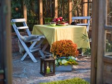 An autumnal atmosphere on a terrace set for supper for two
