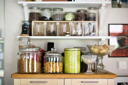 Storage jars and tins on a kitchen cupboard