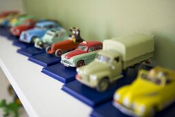 Tin cars on a shelf