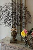 Sea sponge skeleton and flower vase on a vintage table top