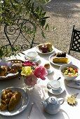 A breakfast table outside in the sun