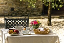 A garden table laid for breakfast