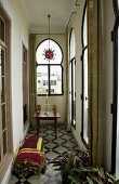 Loggia with oriental style lancet windows and patterned tile floor