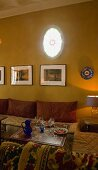 Mood lighting in a Moroccan living room with pillows and upholstered seating around a side table
