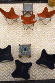 View of a classic chairs with brown and black fabric with oriental side tables and tiles in a herring bone pattern