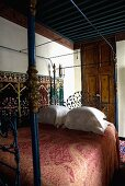 Oriental bedroom with a canopy bed