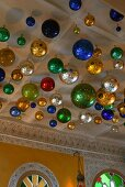 Colorful metal balls hanging from a ceiling