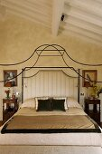 Bedroom beneath a ceiling -- elegant canopy bed frame made of curved metal