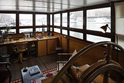 House boat with wooden built-ins in the lounge and a view out of the panoramic windows