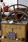 Close up of a wooden steering wheel in a house boat