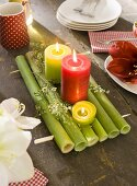 A Christmas atmosphere on an old wooden table with coloured candles