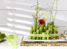 An arrangement of flower stems, poppies, amaryllis and twigs