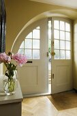 A hallway in a country house with an arched entrance way