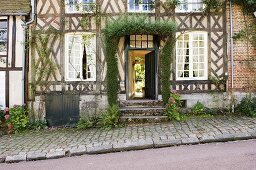 An old half-timbered house with an open front door