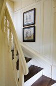 A white, wood panelled, country house-style stairway