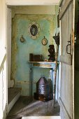 An open wooden door providing a view onto an old corner table