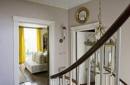 An elegant stairway with an open door and view into the living room
