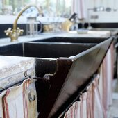 An old double kitchen sink with brass taps
