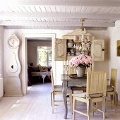 A dining area in a 19th century German thatched-roof house decorated in Scandinavian style