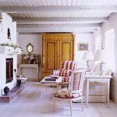 A living room with a fireplace in a 19th century German house decorated in Scandinavian style