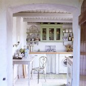 A kitchen in a 19th century German thatched-roof house decorated in a Scandinavian style