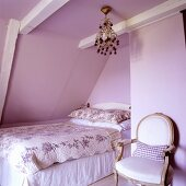 A bedroom in a 19th century German thatched-roof house decorated in a Scandinavian style