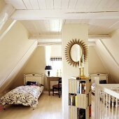 A bedroom with two single beds in a 19th century German thatched-roof house decorated in a Scandinavian style