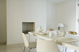 Breakfast in a white dining room - minimalistic design