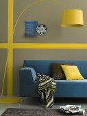 A yellow lamp and a blue sofa