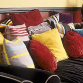 Various coloured sofa cushions