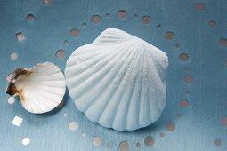 A bath salt shaped like a shell and a real shell