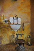 Wall mounted washbasin in rustic bathroom
