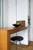 Bar stool at breakfast bar in modern kitchen