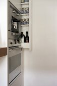 Integral oven in modern kitchen with pull-out storage