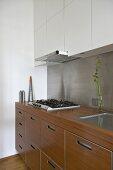Gas hob set in worktop in modern kitchen