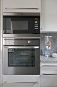 Integral stainless steel oven in modern kitchen