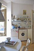 Modern kitchen with freestanding oven and washing machine