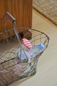 Bottle and jar in wire basket