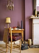 Pine table and chair in room with plum coloured walls