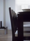 Close up of black dining table and chairs
