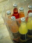Bottles of drink in plastic inflatable drinks chiller