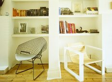 Two retro style chairs in front on white shelving unit