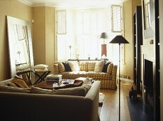 Pair of upholstered sofas facing each other over coffee table in front of fireplace