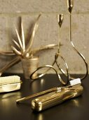 Various golden bath utensils (toothbrush, nail brush, etc)