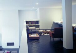 Seats, a side table and a bookshelf on a mezzanine floor