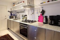 A kitchen with stainless steel cupboards