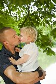 A father kissing his little daughter