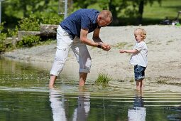 A father and a daughter playing in a lake