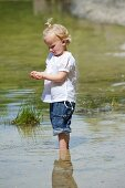 A little girl in a lake